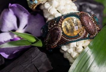 beaded bracelet on jasmine flowers.
