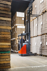 Reach truck in a warehouse