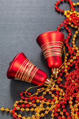 Red bells on black background. Christmas decorations.