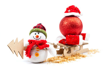 Snowman with sled, Christmas tree and New Year's bal.