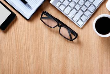 Eye Glasses on Businessman Table