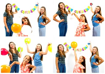 Smiling girls with balloons and happy birthday written