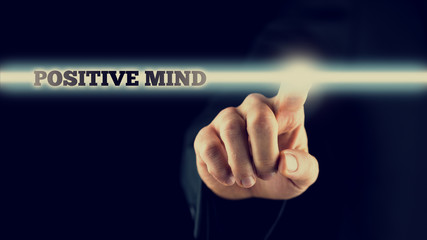 Hand Touching Positive Mind Statement on Touch Screen