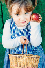 Proud cute todler showing her apple