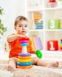 cute kid playing with color toy indoor poster