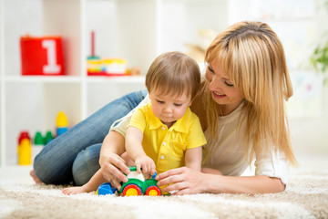 child boy and woman playing with toy indoor