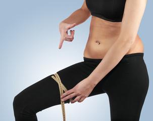 Hand measuring leg, weight loss concept.