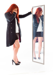 model isolated on plain background ashamed hiding face in hand