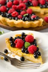 custard tart with raspberries and blueberries