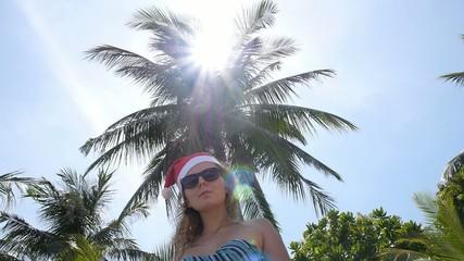 Christmas and New Year 2015 - Woman in Santa Hat in Bikini. Slow
