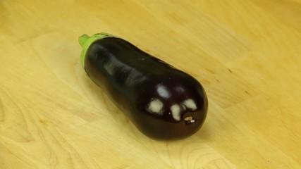 Raw eggplant rotates