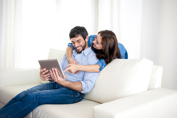 young couple at home enjoying digital tablet computer
