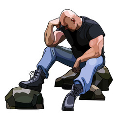 sad big bald man sitting on the rocks