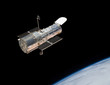 Hubble Space Telescope in orbit above the Earth. - 72364254