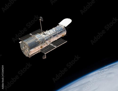 Leinwanddruck Bild Hubble Space Telescope in orbit above the Earth.