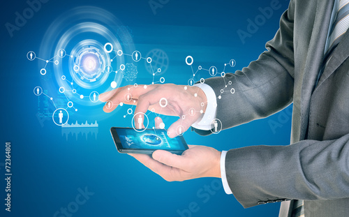 canvas print picture Man hands using smart phone. Earth on phone screen