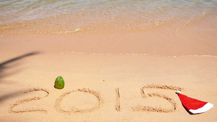 Happy New Year 2015 with Santa Hat on Beach with Wave. Slow