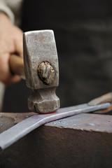 Forging hot iron
