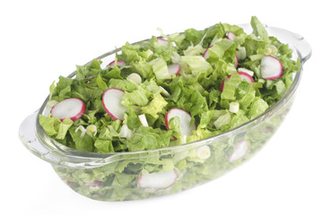 Fresh salad in glass bowl isolated on white background