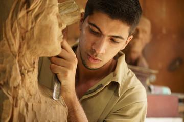 Sculptor young artist artisan working sculpting sculpture