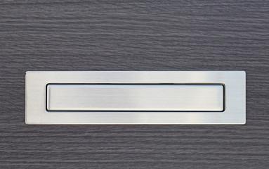 Metal post box and modern wood door