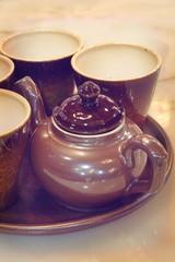 Set of Brown ceramic tea pot and ceramic tea cup