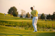 Man playing golf during evening