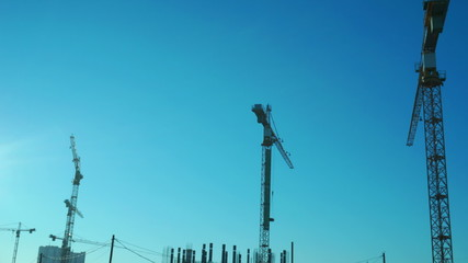 Crane working in construction site. Time lapse.