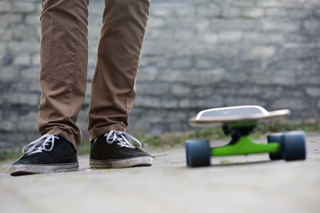 Skateboarder feet and skateboard in urban setting