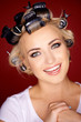 Cute blond woman with her hair in curlers