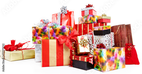A pile of Christmas gifts in colorful wrapping with ribbons. - 72371232