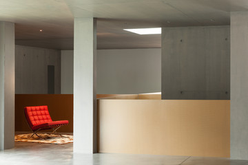interior house, concrete wall, red armchair