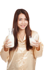 Happy Asian woman drink milk in morning