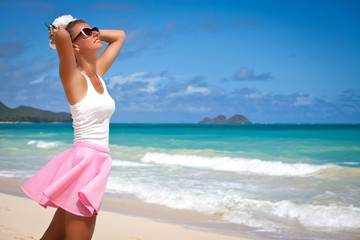 Carefree freedom girl in summer day. on the tropical beach.