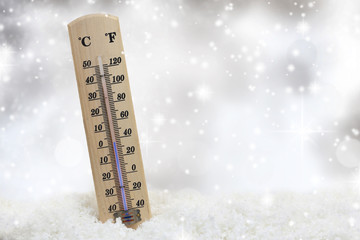 Thermometer on snow shows low temperatures