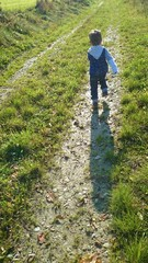 Boy running through nature colorvariant