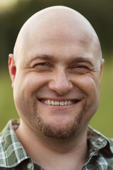 Happy smiling bald man