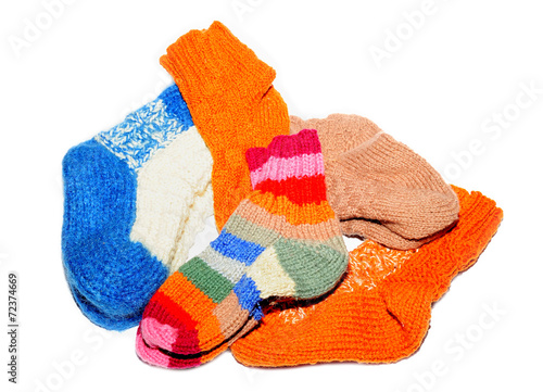 canvas print picture Warm knitted woolen socks knitting needles isolated on a white b