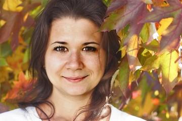Portrait of Woman on Autumn Background