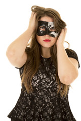 woman mask hands hair serious