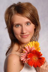young girl with gerberas