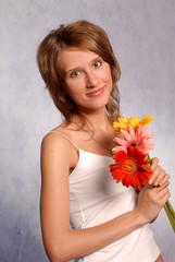 young girl with gerbera, close up, studio