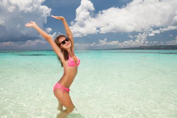 Beautiful girl standing in water