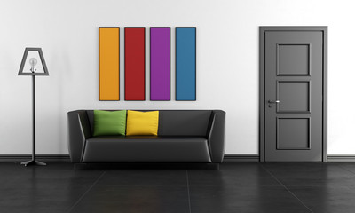 Modern black lounge with colorful paintings
