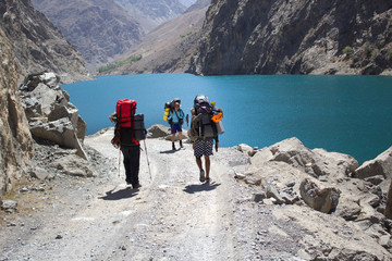 group of backpackers hiking in high mountains of central Asia, T