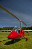 Red open-cockpit autogyro