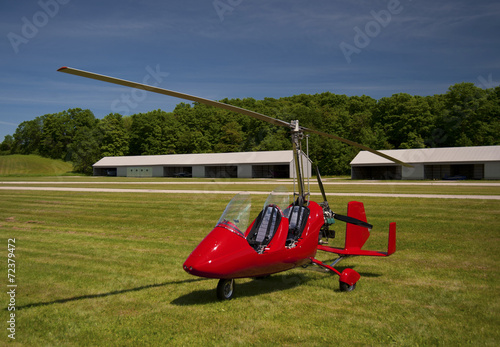 Red open-cockpit autogyro - 72379472
