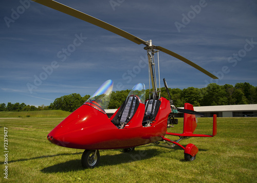 Red open-cockpit autogyro - 72379477