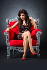 Young woman in a red chair. Retro style.