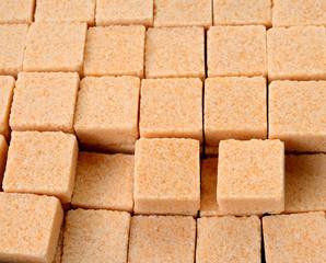 Cubes of cane sugar isolated on white background